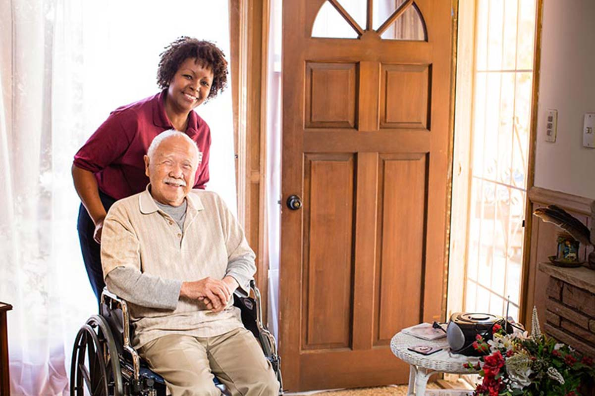 A Home Instead CAREGiver helping a senior with daily tasks
