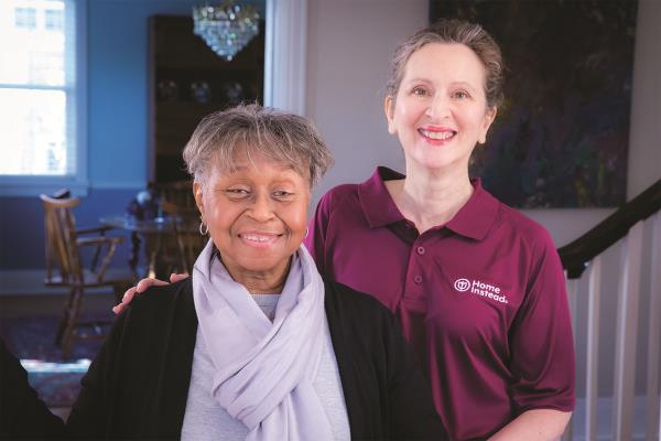 Female CAREGiver and female client smiling